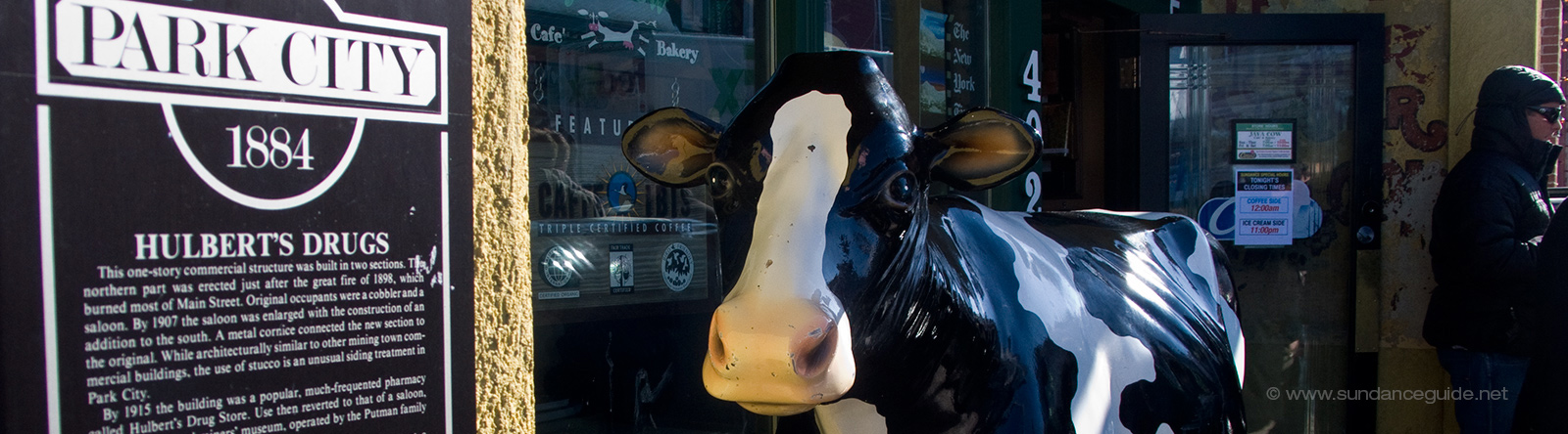 A picture of a cow sculpture on the street in Park City, Utah